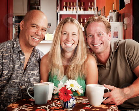 Three Friends in a Coffee House stock photo, Three adult friends smiling in a coffee house by Scott Griessel