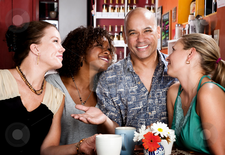 Man with three pretty women in coffee house stock photo, Man with shaved head and three pretty women in coffee house by Scott Griessel