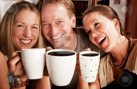 Toasting with Coffe Cups stock photo, Three friends in a coffee house toasting with their cups by Scott Griessel