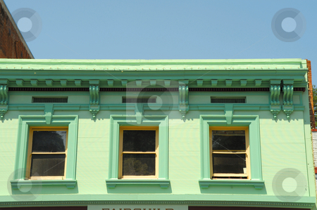 Green Building stock photo, An Old West building painted various shades of green on Main Street in Placerville California by Lynn Bendickson
