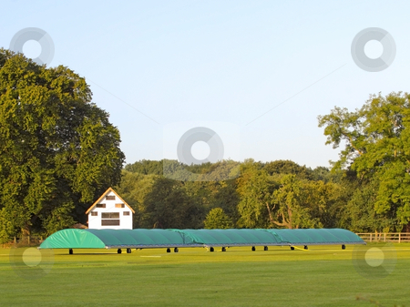Cricket scoreboard and covers stock photo, A cricket ground in summer with scoreboard and covers by Mike Smith