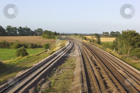 Railway tracks stock photo, Railway tracks cutting through rural countryside in late summer by Mike Smith