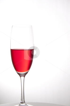 Red party drink isolated on white stock photo, Red cocktail for a party or celebration served in a champagne glass by Daniel Kafer