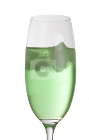 Green party drink with ice stock photo, Bright green drink in a tall champagne glass with ice cubes by Daniel Kafer