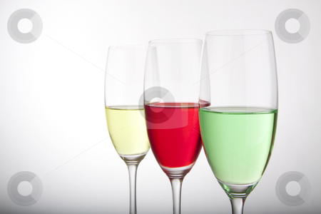 Row of three colorful cocktails stock photo, Colorful cocktails for a party or celebration served in a champagne glass by Daniel Kafer