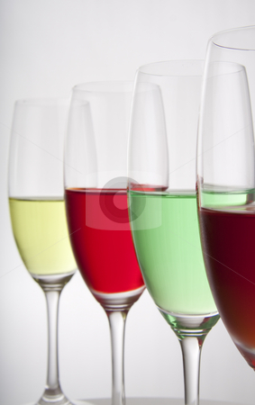 Four colorful party drinks stock photo, Colorful cocktails for a party or celebration served in a champagne glass by Daniel Kafer