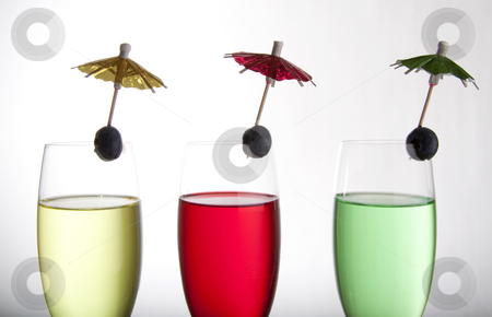 Drinks and umbrellas stock photo, Colorful cocktails for a party or celebration served in a champagne glass by Daniel Kafer