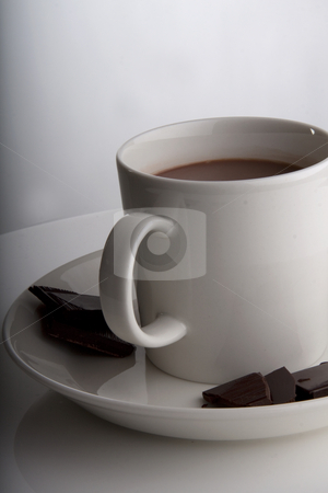 Cup of hot chocolate stock photo, Hot chocolate in a white cup with peices of dark deluxe chocolate on the side by Daniel Kafer