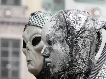 Street performers stock photo, Two street performers wearing scary masks in the city of Krakow Poland by Laurent Dambies