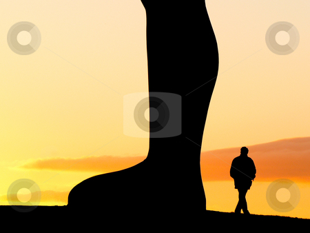 Evening walk stock photo, Silhouette of a man walking around the  Angel of the North sculpture at sunset in Gateshead by Laurent Dambies