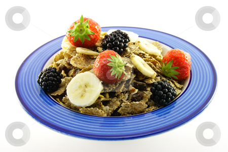 Bran Flakes in a Blue Bowl stock photo, Crunchy looking delicious bran flakes and juicy fruit in a blue bowl on a white background by Keith Wilson