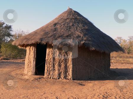 African Hut stock photo, Straw roof hut in Africa by Neel Breitenbach