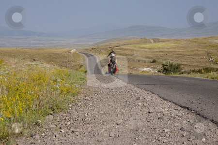 Man on bicycles stock photo, Travel by bicycles in Armenia - man on the bicycles on the route by Tomasz Parys