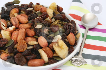 Bowl of Nuts stock photo, Bowl of nuts, raisins and other dried fruits with a spoon by Vanessa Van Rensburg