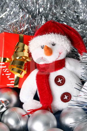 Christmas Gifts stock photo, Wrapped christmas gifts with tinsel and snowman decoration by Vanessa Van Rensburg