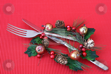 Christmas Dinner stock photo, Knife and Fork in a christmas decoration as a table setting by Vanessa Van Rensburg