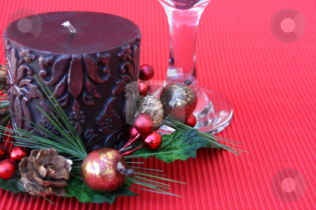 Candle and Glass stock photo, Christmas Table setting with candle and wine glass by Vanessa Van Rensburg