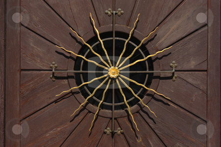 Golden sun on a wooden door stock photo, Golden sun on a wooden door in Neustift / Austria by Andre Janssen