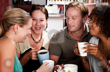 Four Friends in a Coffee House stock photo, Diverse group of four friends in a coffee house by Scott Griessel