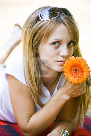 Beautiful young woman with flower stock photo, Beautiful young blonde woman with flower by Desislava Dimitrova