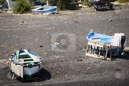 Rural fisherman rowboat stock photo, Image shows a small rowboat boat of fisherman at stromboli. by Antonino Sicali