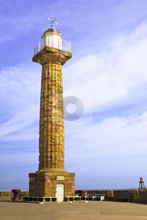 A column with weather vane stock photo, A column in a harbour at a seaside town in summer by Mike Smith