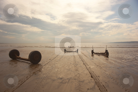 Trailers on beach in the evening stock photo, Boat trailers on a beach in summer by Mike Smith