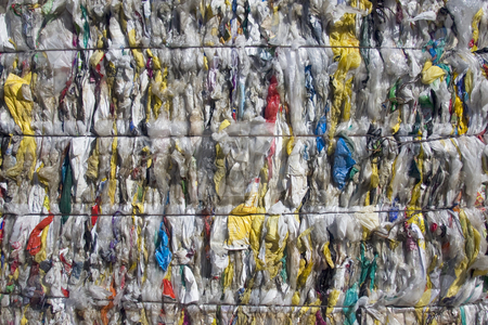 Plastic bags stock photo, Plastic shopping bags squashed into bales for recycling by Darren Pattterson