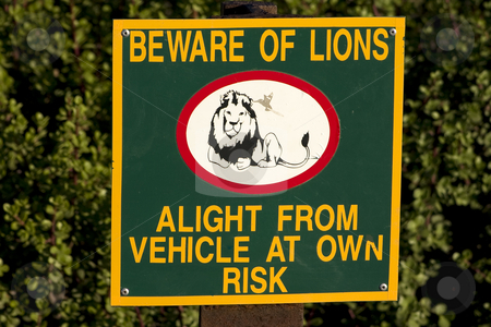 Beware of Lions stock photo, Sign in southern african game park warning of the dangers of leaving your vehicle by Darren Pattterson