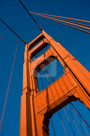 Golden tower stock photo, Close up of one of the towers of the Golden Gate bridge by Darren Pattterson