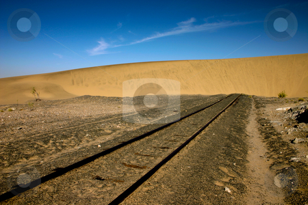 End of the line stock photo, Sand dune that has engulfed a railway line in Namibia by Darren Pattterson