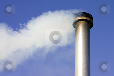 Smoking chimney stock photo, A chimney with white smoke coming out of it with a blue sky background by Darren Pattterson
