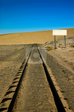 No way ahead stock photo, Sand dune that has engulfed a railway line in Namibia by Darren Pattterson