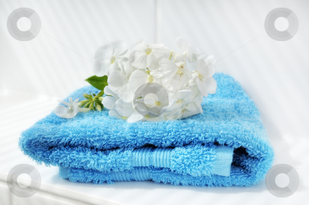 Towel stock photo, Blue towel with a white flower in the bathroom by Carmen Steiner