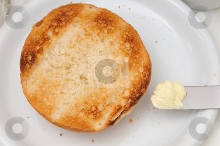 Simple breakfast stock photo, Half of a bread roll an a little bit butter by Carmen Steiner
