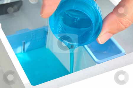 Conditioner stock photo, Pour Conditioner into a washing machine by Carmen Steiner