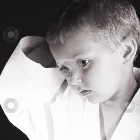 Karate Boy stock photo, Young boy wearing his karate uniform on a black background by Vanessa Van Rensburg