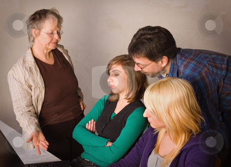 Difficult task stock photo, Two teenager girls doing their homework together with their parents by Mikhail Lavrenov