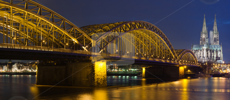 Night panoram of Cologne stock photo, Night panoram of Cologne Cathedral and railway bridge over river Rhine by Mikhail Lavrenov