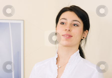 Smiling girl stock photo, Smiling brunette girl in formal dress by Mikhail Lavrenov
