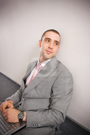 Thoughts stock photo, Thoughtful man in formal dress sitting on the floor with his laptop by Mikhail Lavrenov
