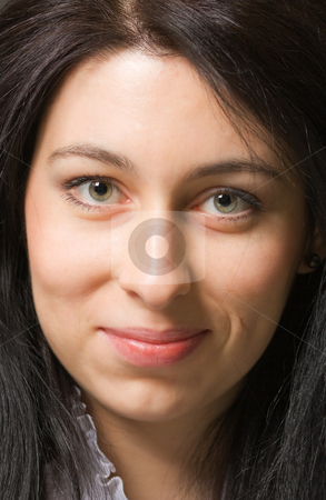 Smiling girl stock photo, Closeup portrait of a smiling brunette girl by Mikhail Lavrenov