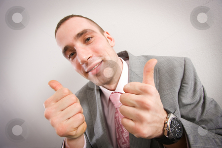 Achievement - thumbs up stock photo, Young businessman showing thumbs up by Mikhail Lavrenov