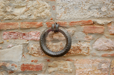 Iron ring stock photo, Closeup of an iron ring on a wall by ALESSANDRO TERMIGNONE