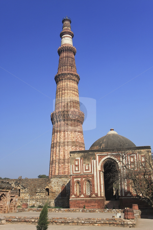 Qutb Minar, Delhi, India stock photo, Qutub Minar is the tallest brick minaret in the world at 72.5 meters. Commenced by the first Muslim ruler of Delhi in 1193, it was only completed in 1368. It is now listed as a UNESCO World Heritage Site. by Sharron Schiefelbein
