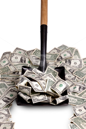 Money by the shovel full stock photo, Shovel clears a path thru a pile of dollar bills by James Barber
