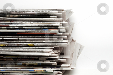 Pile of Newpapers stock photo, Pile of newspapers shot close-up allowing for type on right side by James Barber