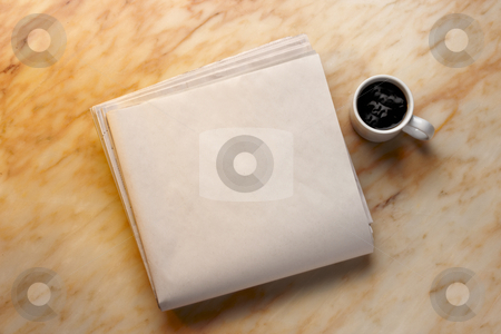 Morning paper stock photo, Blank newspaper and cup of coffee on marble surface. Add your own copy. by James Barber