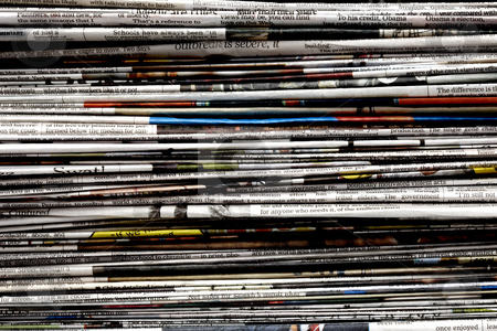 Stack of Newspapers stock photo, Stack of newspapers shot close-up fills frame by James Barber