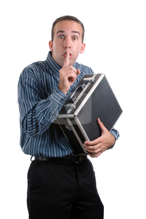 Employee Thief stock photo, A young employee is sneaking away a case of private documents and telling the viewer to be quiet, isolated against a white background by Richard Nelson